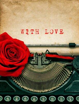 Naklejka Maszyny do pisania czerwony kwiat róży. Z miłością