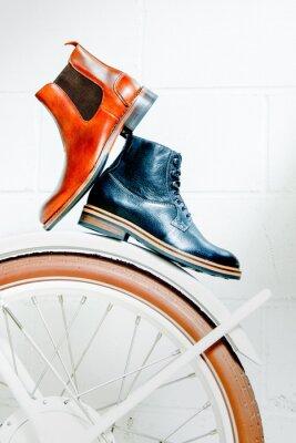 Naklejka Men leather boots on bicycle wheel