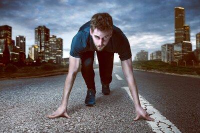 Naklejka Mężczyzna biegacz jest gotowy do rozpoczęcia