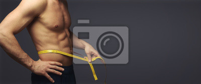 Naklejka Mężczyzna mierzy obwód talii / dietę / odchudzanie