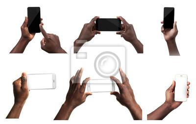 Naklejka Mężczyzna ręce gospodarstwa inteligentny telefon komórkowy i tablet z pustego ekranu, na białym tle.