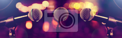 Naklejka Microphone and stage lights.Concert and music concept.Live music and conference background.Karaoke and entertainment concept.