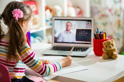 Naklejka Middle-aged distance teacher having video conference call with pupil using webcam. Online education and e-learning concept. Home quarantine distance learning and working from home.