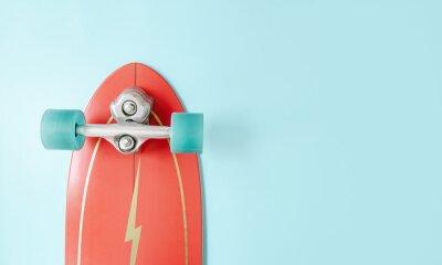 Naklejka Minimal red surf skate or skateboard on blue color background. Sport activity lifestyle concept, Copy space.