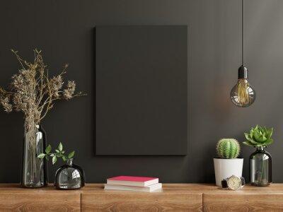 Naklejka Mockup frame on cabinet in living room interior on empty dark wall background.