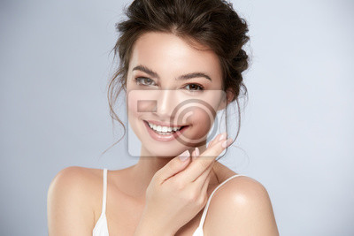 Naklejka model with perfect smile and beautiful face isolated on grey
