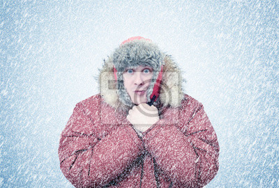 Naklejka Mrożone mężczyzna w zimie odzież ciepłe rąk, zimno, śnieg, zamieć