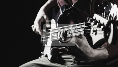 Naklejka Music concept. Electric guitar. Copy space. Play the guitar. Live music background. Music festival. Instrument on stage and band. Black and white.