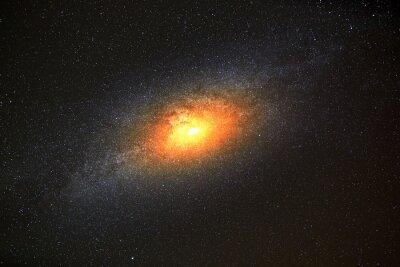 Naklejka Najjaśniejszą galaktyką na tle ciemnego nieba z gwiazdami