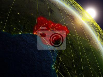 Naklejka Nigeria z kosmosu na realistycznym modelu planety Ziemia z siecią. Pojęcie technologii cyfrowej, łączności i podróży.