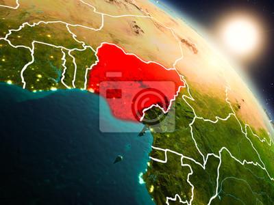 Naklejka Nigeria z kosmosu podczas wschodu słońca