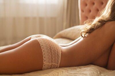 Naklejka Nude woman wearing panties in bed