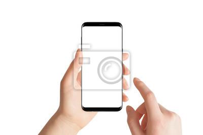 Naklejka Odosobnione ręki i smartphone na białym tle. Żeńska ręka trzyma nowożytnego czarnego telefon w pionowo pozyci.