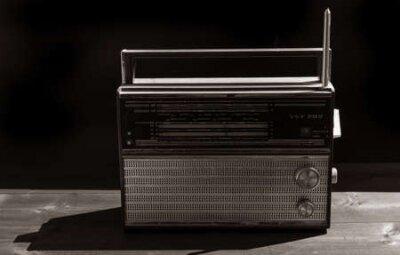 Naklejka Old radio on a black background