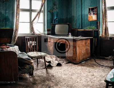 Naklejka old tv and different garbage in abandoned room