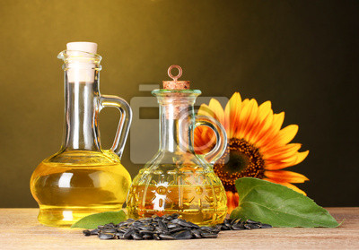 Naklejka olej słonecznikowy i słonecznika na żółtym tle