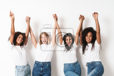 Naklejka Optimistic cheery young women multiracial friends