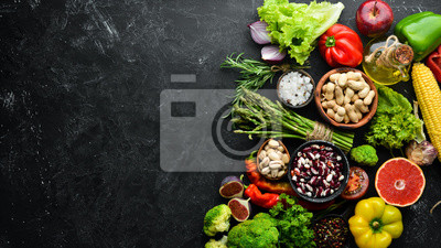 Naklejka Organic food. Fresh vegetables and fruits. Top view. Free copy space.