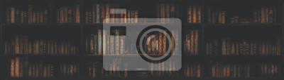 Naklejka panorama blurred bookshelf Many old books in a book shop or library