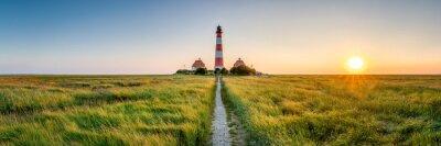 Naklejka Panorama of the Westerheversand Lighthouse at Westerhever in Nordfriesland in the German state of Schleswig-Holstein