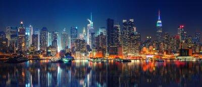 Naklejka Panoramic view on Manhattan at night, New York, USA