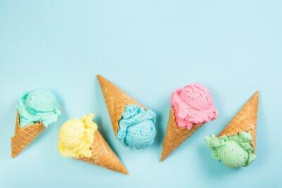 Naklejka Pastel ice cream in waffle cones, bright background, copy space
