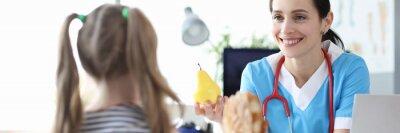 Naklejka Pediatrician doctor tells little girl benefits of healthy eating