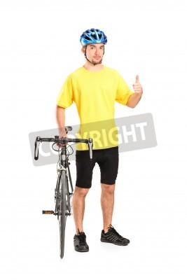 Naklejka Pełna długość portret uśmiechniętego rowerzysty stwarzających obok roweru i daje kciuk w górę na białym tle