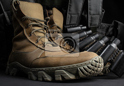 Naklejka Photo of a pair of military boots with armor vest.
