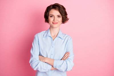 Naklejka Photo of attractive charming business lady smiling hold arms hands crossed good mood self-confident successful worker person wear blue shirt isolated pink color background