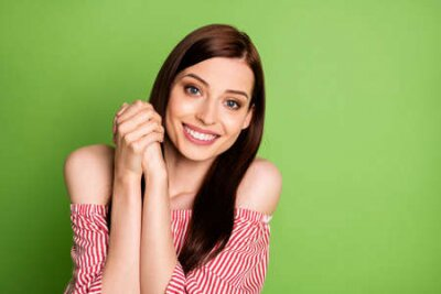 Naklejka Photo of cute adorable student girl look camera smiling thankful appreciate guy help repare computer wear striped white red blouse uncovered shoulders bright green color background