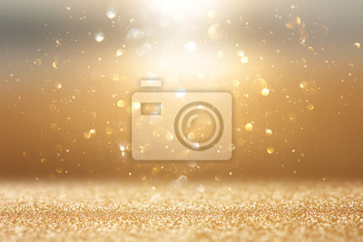 Naklejka photo of gold and silver glitter lights background