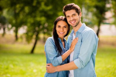 Naklejka Photo of pair enjoying sunny day and park walk wear casual denim outfit