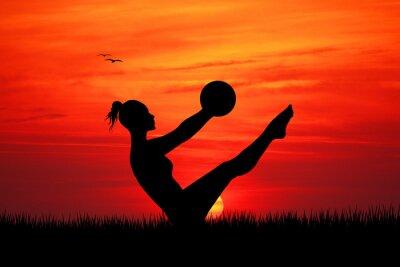 Naklejka Pilates na zachodzie słońca