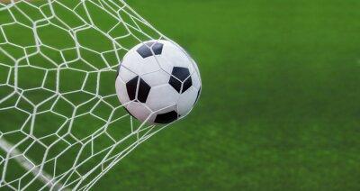 Naklejka Piłka nożna w bramce z zielonym backgroung