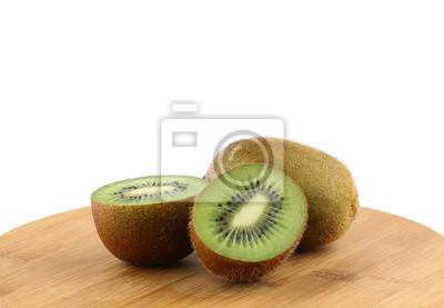 Naklejka Plasterkach soczyste owoce kiwi na drewnianej tablicy