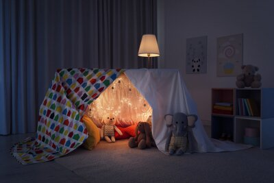 Naklejka Play tent decorated with festive lights in modern child's room
