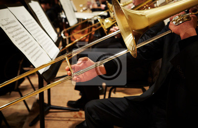 Naklejka Playing the trombone in orchestra