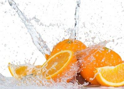Naklejka Pomarańcze z plusk wody