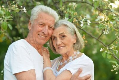 Naklejka Portrait of beautiful senior couple posing in the park