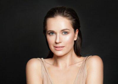 Naklejka Portrait of beautiful smiling woman with clear skin