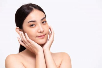 Naklejka Portrait of beauty Asian woman clear healthy perfect skin isolated on white background. Beauty clinic facial treatment skincare concept