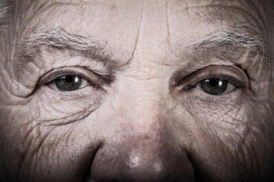 Naklejka Portrait of elderly woman. Closeup view. Toned.