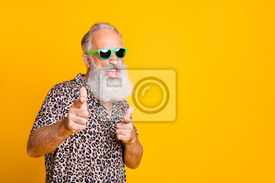Naklejka Portrait of funky old bearded man in eyeglasses eyewear feel cool crazy point at you wearing leopard shirt isolated over yellow background