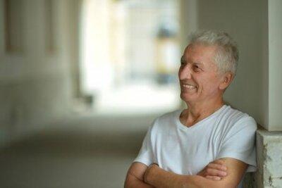 Naklejka Portrait of happy senior man at home
