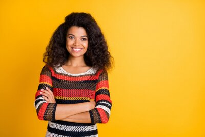 Naklejka Portrait of her she nice attractive lovely charming cute pretty cheerful cheery wavy-haired girl wearing knitted sweater folded arms isolated over bright vivid shine vibrant yellow color background