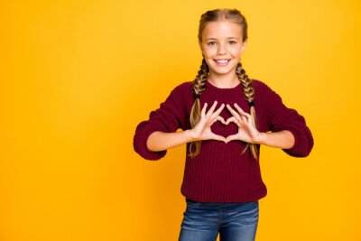 Naklejka Portrait of her she nice attractive lovely cute cheerful cheery glad kind pre-teen girl showing heart peace gesture isolated over bright vivid shine vibrant yellow color background