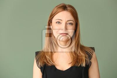 Naklejka Portrait of mature woman on color background