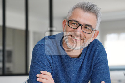 Naklejka Portrait of smiling man with grey hair and glasses