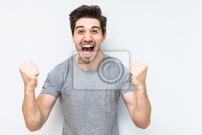 Naklejka Portrait of smiling man with the fists up isolated a white background